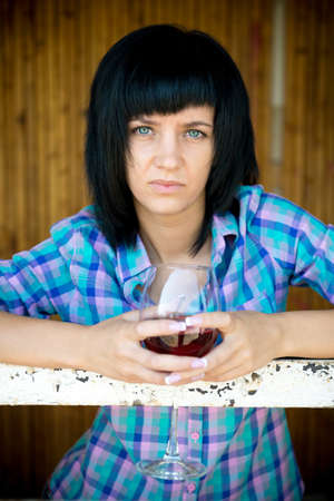 downcast: The portrait young girl with a wine glass in the destroyed building