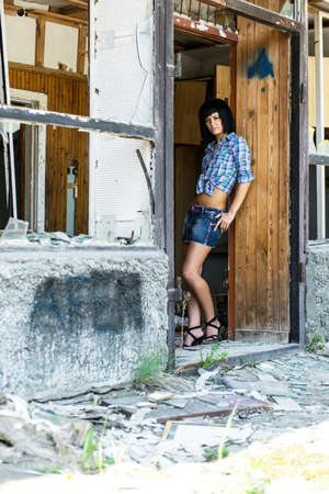 The sexual girl near the destroyed house photo