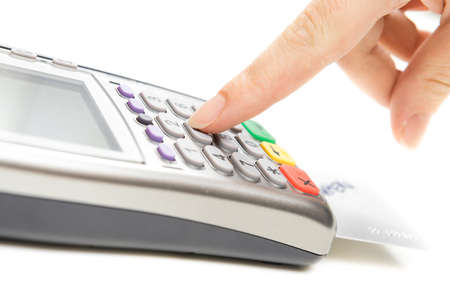 pin code: Payment terminal - a finger entering the PIN code
