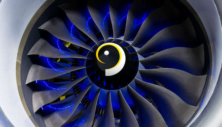 Turbo-jet engine of the plane on close up. Blue light