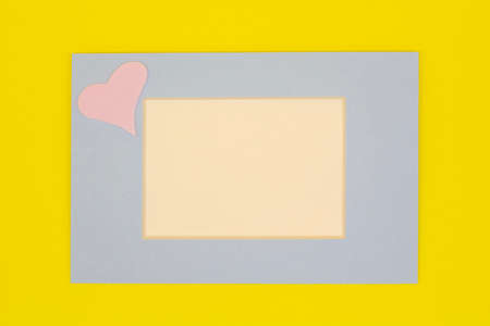 blue frame with space for your text on a yellow background.valentine's day