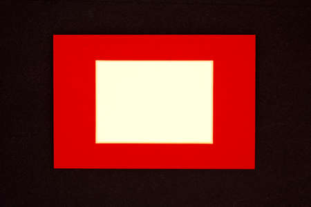 red frame with space for your text on a black background Standard-Bild
