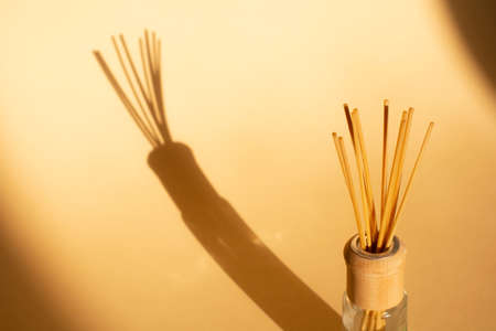 aroma rattan sticks for scenting the room on a beige background