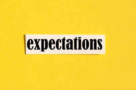 The word expectations on a yellow background. concept.the concept of expectations