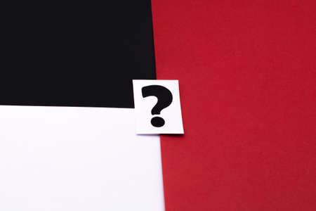 a question mark on a white sheet. FAQ frequency asked questions, Answer and Brainstorming Concepts