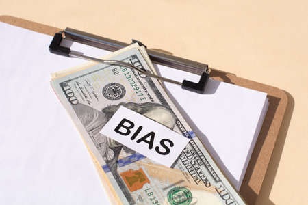 the word Bias and and 100 dollar bills. Prejudice. Personal opinions. Preconception