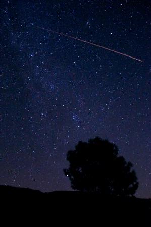 california: Meteor streaking across the starry sky in Descanso, California   Stock Photo