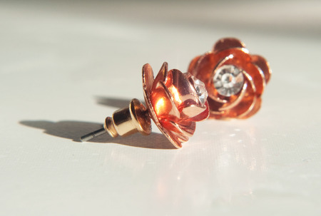 Close-up of rose gold stud earrings photo
