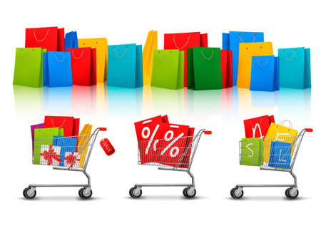 shopping bags: Background with shopping color bags and shopping carts with sale. Concept of discount.