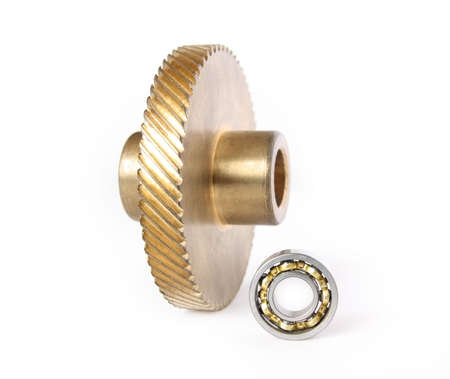 Bronze gear and ball bearing on a white background      photo