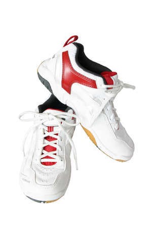Red - white running shoes on a white background photo
