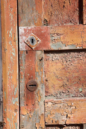 Fragment of an old, shabby brown door, two keyholes Stock Photo - 6796794