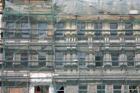 scaffolds: Restoration of old buildings equipped with scaffolds Stock Photo