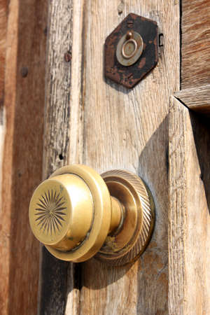 The old wooden door with bronze handle Stock Photo - 7033924