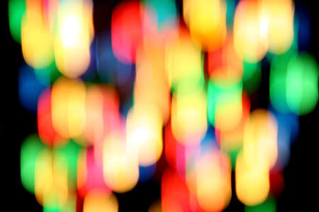 Multicolored spots of light against a black background Stock Photo - 7167169