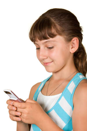 The smiling girl with a mobile phone on a white background Stock Photo - 7340624