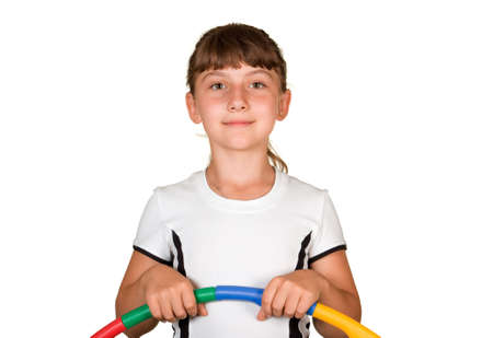 The girl with a gymnastic hoop on a white background  photo
