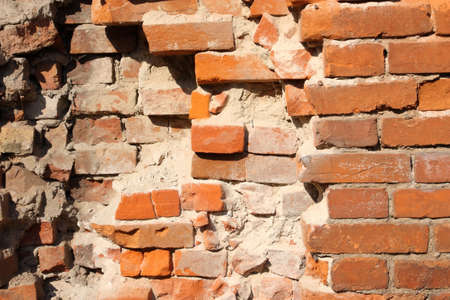 crumbling: It depicts an old brick wall crumbling