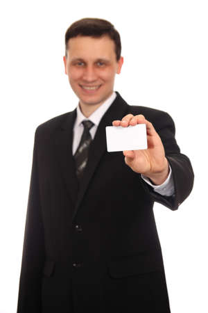 Businessman showing his business card on a white background photo