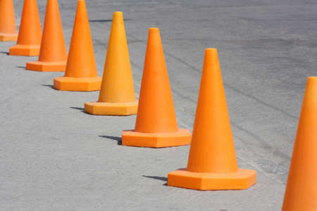 warning signs: Orange cone. Road warning signs standing in a row Stock Photo