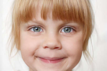 human head faces: Little girl smiling closeup on white background