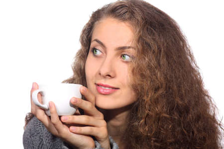 Beauty young woman holding a cup on a white background photo