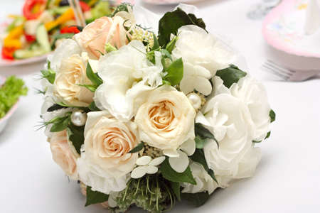 Wedding bouquet of white roses lying on the holiday table Stock Photo - 13615023