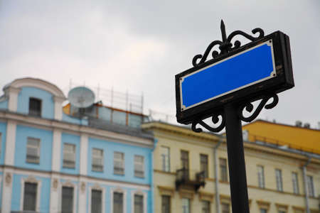 travelled: Pointer, sign on the background of buildings and sky