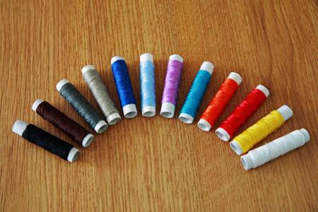 skein: Skein of colored thread on a brown wooden background