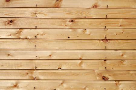 nailed: Boardwalk wall nailed with knots
