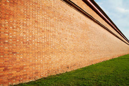 red wall: Brick wall in perspective, receding into the distance