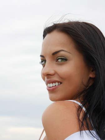 mulatto: Beautiful green-eyed mulatto girl, smiling looks into the camera outdoors Stock Photo