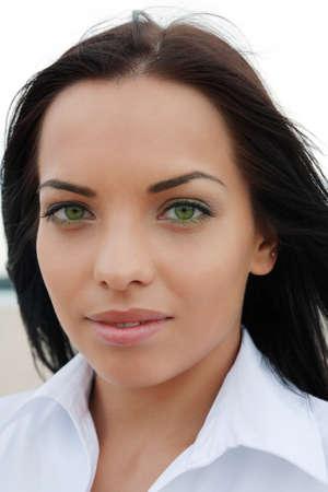 mulatto: Beautiful green-eyed mulatto girl, looks into the camera outdoors