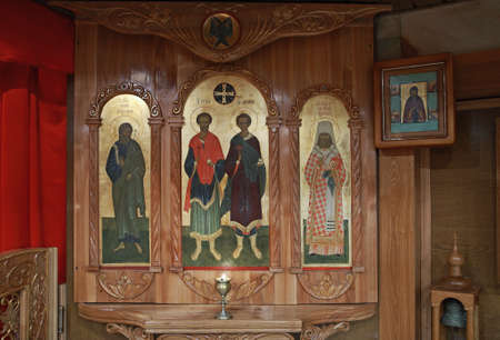 Orthodox iconostasis, the holy martyrs Cosmas and Damian, Apostle Andrew, Holy Martyr Vladimir, Metropolitan of Kiev