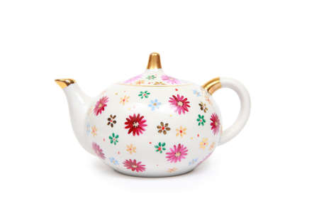 Teapot decorated with flowers isolated on a white background