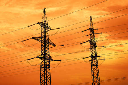 High-voltage networks, silhouettes at sunset