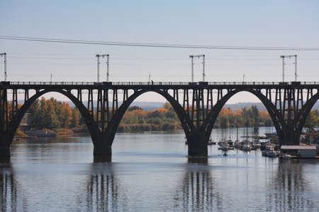 """Merefo-Kherson"" railway bridge in Dnepropetrovsk, yacht mooring, Ukraine"
