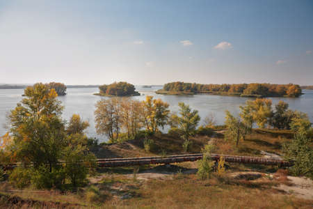 Islands on the Dnieper River, pipeline across the river, autumn landscape