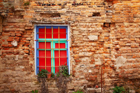 Window in an old brick wall in an abandoned house