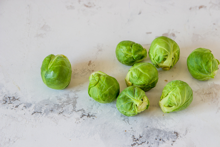 Fresh Brussels sprouts on a white background top view.