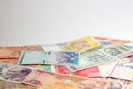 Money banknotes from multiple countries, copy space. Stock Photo