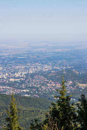 Almaty city view from mountain top. Stock Photo