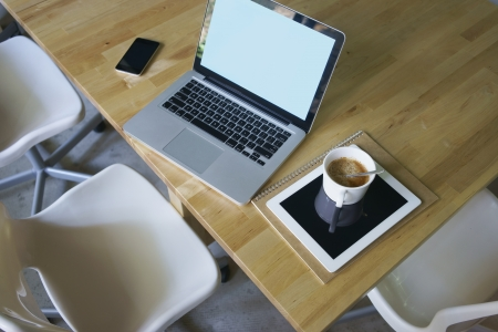 laptop,pad,notebook,mobile phone and notebook on table photo