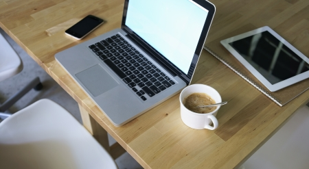 laptop,pad,notebook,mobile phone and notebook on table Standard-Bild