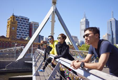 travelers on bridge Standard-Bild