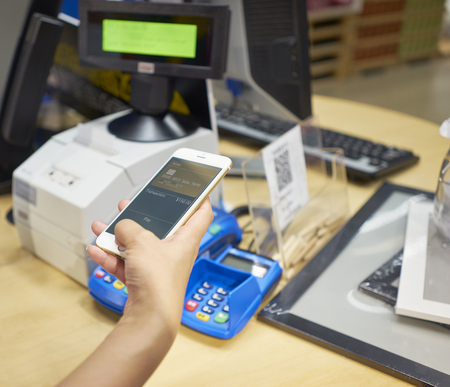 closeup of hand completing mobile payment