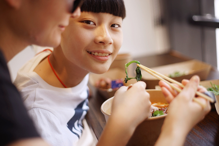 Asian mother have lunch with son in a restaurant