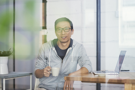 Portrait of Asian businessman smiling and looking at camera