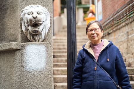 portrait of senior Asian woman traveling in old town Stock Photo