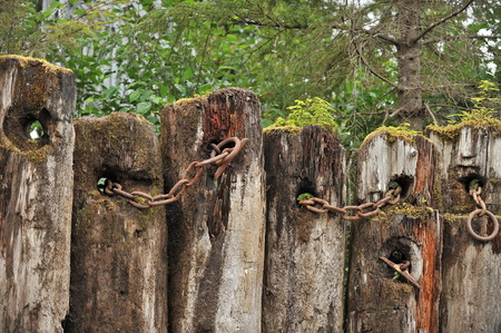 Log and chain fence Stock Photo